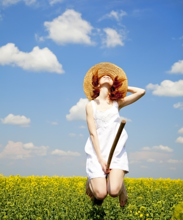 Redhead enchantress fly over spring rapeseed field at broom.  photo
