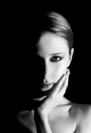 gölge: Girl at black background. Photo in black and white style.