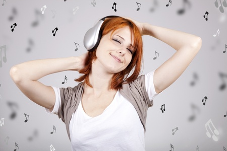 Girl with modern headphones.  Stock Photo - 9495677