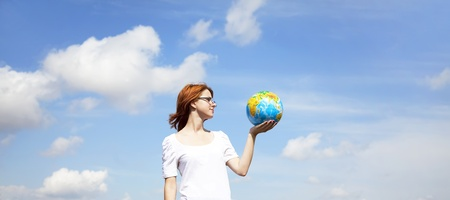 Young Businesswomen in white keeping globe in hand photo