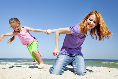 Two happy sisters at summer beach. Stock Photo - 9621541