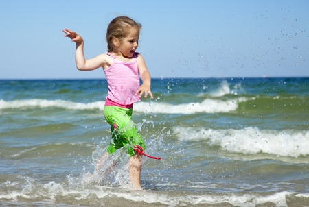 Happy child at the summer beach. Stock Photo - 9621535