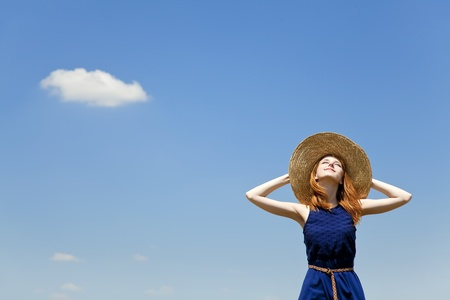 Redhead girl at spring blue sky background. photo