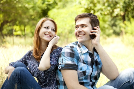 summer time: Couple calling by mobile phone at outdoor in summer time.