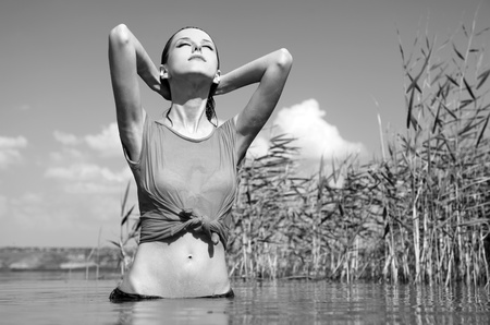 wet jeans: Young and beautiful savage girl in the river. Photo in noisy black and white style.