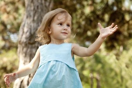 cute little girl smiling in a park Stock Photo - 10568862