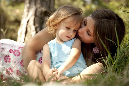 causal: Little girl and mother in the park