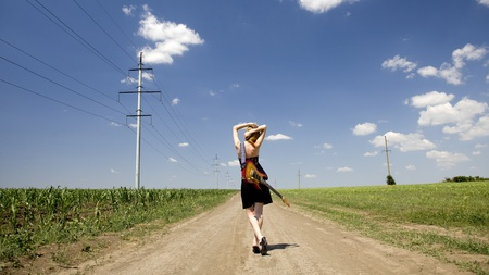Rock girl with guitar at countryside.  photo