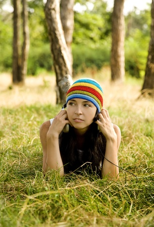 Girl with headphone in the park. photo