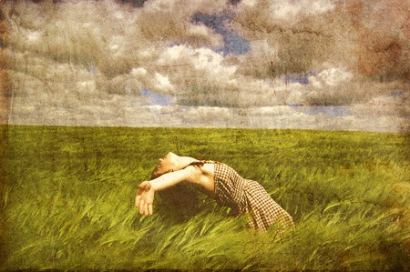 barley field: Beautiful young irl at green field.  Photo in old color image style.