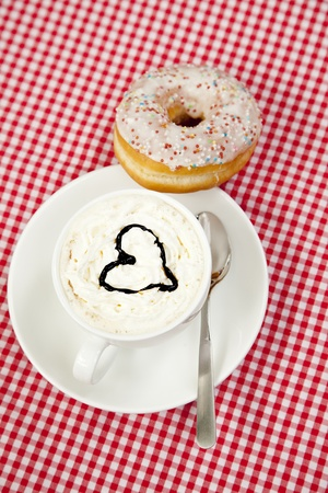Donuts with coffee on table. photo