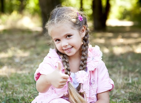 beautiful blonde girl with green eyes: Cute little girl at outdoor in fall.