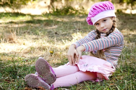 Cute little girl at outdoor in fall. photo