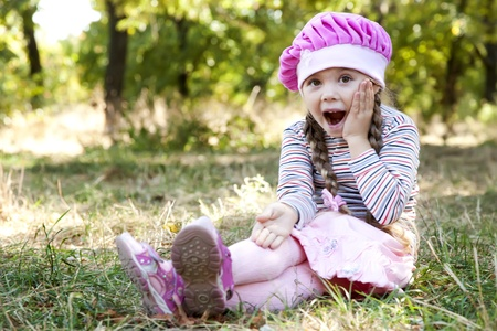 little blonde girl: Cute little girl at outdoor in fall.