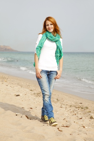 scarf beach: Young beautiful girl at the beach. Stock Photo