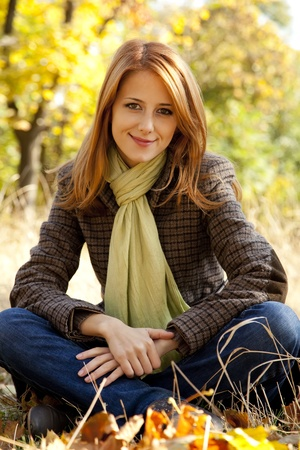 Portrait of red-haired girl in the autumn park. Outdoor shot. Stock Photo - 11011597