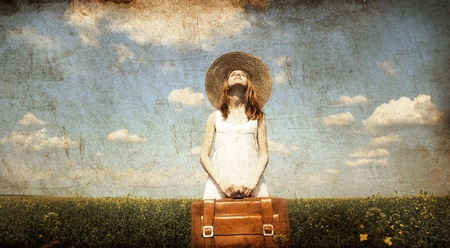 country girls: Lonely girl with suitcase at country. Photo in old color image style Stock Photo