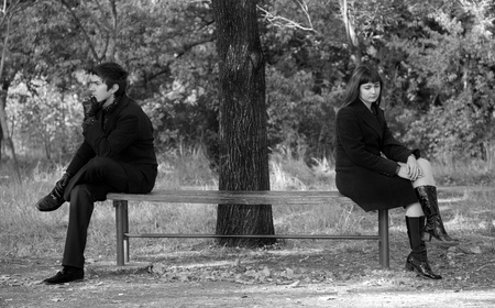 sadness: Two sitting at bench. Photo in old image style.