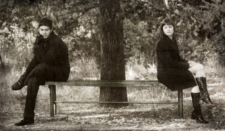 Two sitting at bench. Photo in old image style. photo