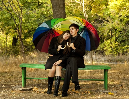 2 way: Couple in the park in fall. Stock Photo