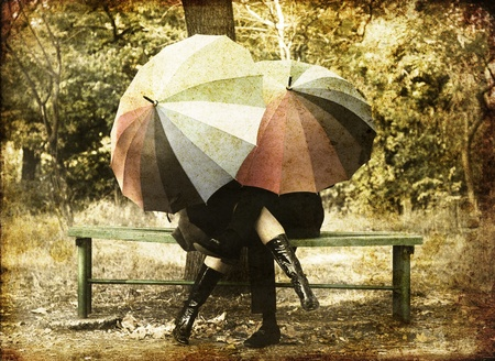 umbrella rain: Couple in the park in fall. Photo in old image style.