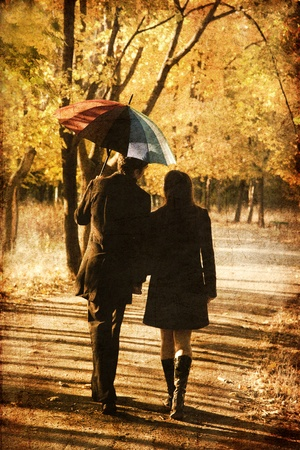 lovers park: Couple walking at alley in autumn park. Photo in old image style.
