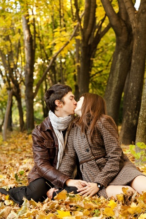 Couple kissing in the park. photo