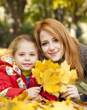 Mother and daughter in autumn yellow park. Stock Photo