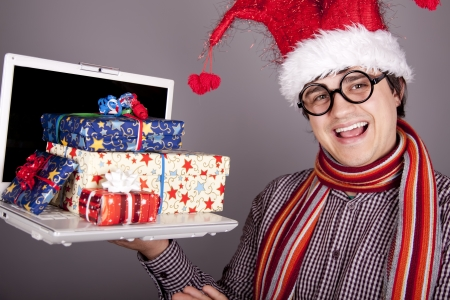 Funny men in christmas cap with gift boxes and notebook. Stock Photo - 16619160