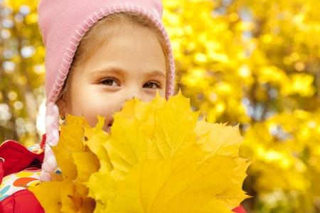 Child in autumn park. Outdoor. photo