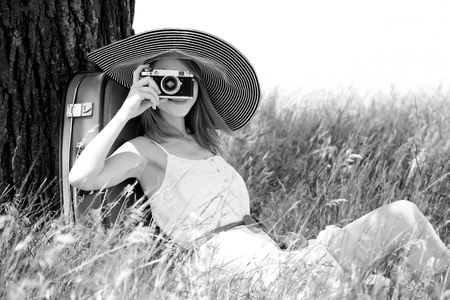 free photo: Girl sitting near tree with vintage camera. Photo in old yellow color image style.