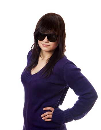 Teen girl in sunglasses. Studio shot. photo