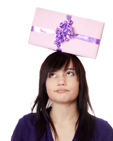 Beautiful brunette girl with present box over head. photo