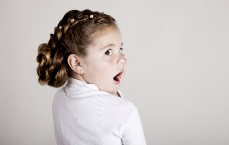 baby hairstyle: Portrait of surprised little girl