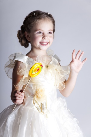 Beautiful pretty little girl with candy photo