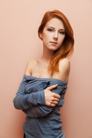 Beautiful redhead girl near wall. Stock Photo - 11670938