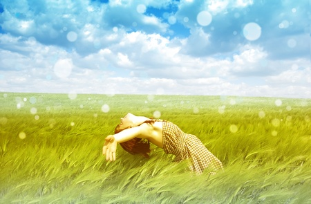 enjoy space: Beautiful young girl at green field Stock Photo
