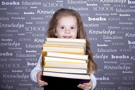 able to learn: Little schoolgirl with books.  Studio shot. Stock Photo