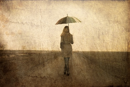 Redhead girl with umbrella at outdoor. photo