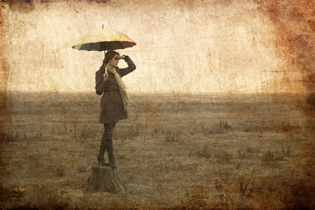 Redhead girl with umbrella at outdoor. Stock Photo - 12323853