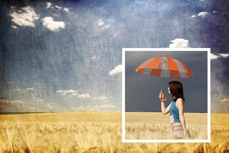 Collage image. Girl with umbrella in storm at wheat field  and sunny day at background. photo