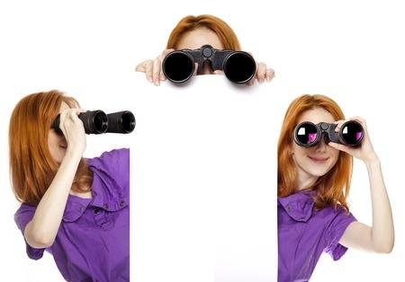Three teen redhead girls with binoculars isolated on white background