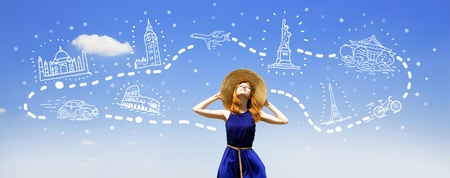 Redhead girl dreaming about traveling around the world. photo