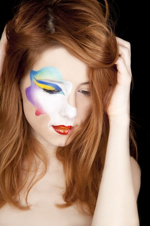 Beautiful redhead girl with make-up. photo
