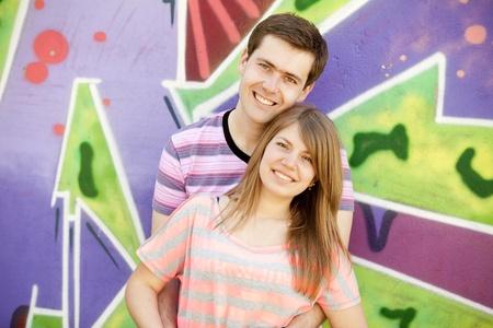 Young couple near graffiti background. Stock Photo - 13504115