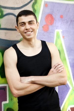 Teen boy near graffiti wall. photo