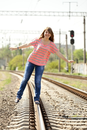 Teen girl at railways. photo