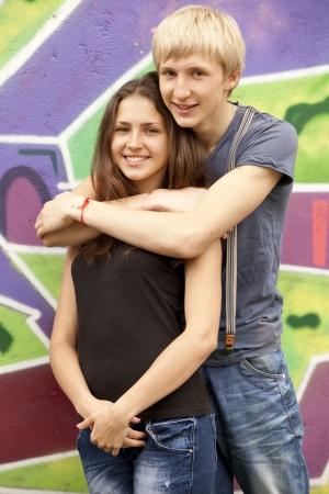 Style teen couple near graffiti background. Stock Photo - 13665963