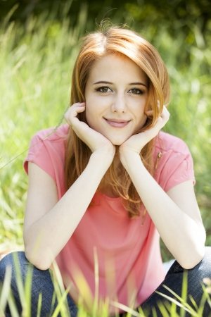 Beautiful redhead girl in the park. Stock Photo - 13916369
