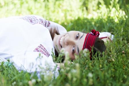 Slav girl at green meadow. Stock Photo - 14011290
